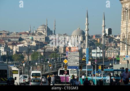 ISTANBUL, TURKEY. A view across the Galata Bridge from Karakoy, with the Yeni & Nuruosmaniye mosques dominating - Stock Photo