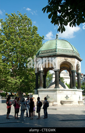 ISTANBUL, TURKEY. Tourists by the Kaiser Wilhelm II fountain (Alman Cesmesi) at the Hippodrome in Sultanahmet district. - Stock Photo