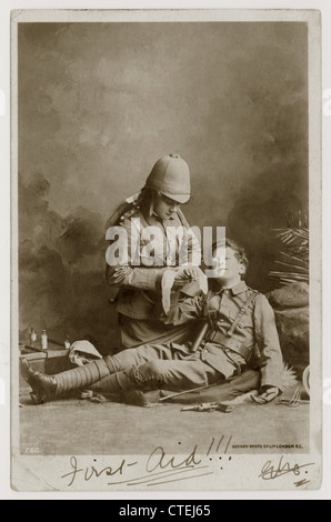 Two children dressed up as Boer war soldiers, one receiving 'first aid' - posted October 1902, from London, U.K.. - Stock Photo