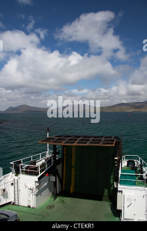 Isle of Harris, Scotland. The Berneray to Harris ferry (MV Loch Portain) with South Harris in the background. - Stock Photo