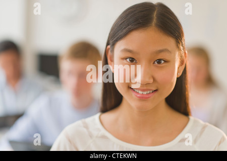 USA, New Jersey, Jersey City, Portrait of female student (14-15) - Stock Photo