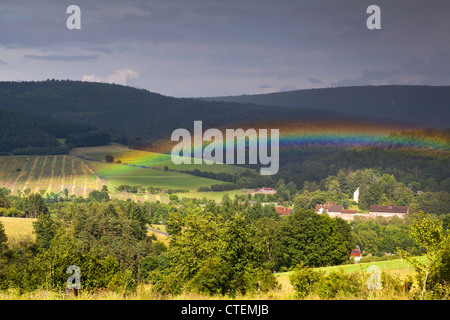 colorful rainbow after shower in mountains - Stock Photo