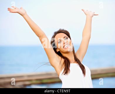 Portrait of a carefree woman enjoying the outdoors - Stock Photo