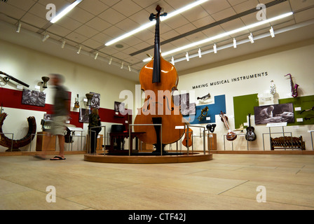 Visitor in motion blur Musical Instruments display Musical Instrument Museum Scottsdale AZ - Stock Photo
