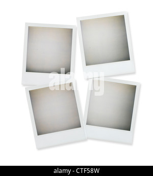 four blank polaroid pictures overhead isolated on white with clipping path - Stock Photo