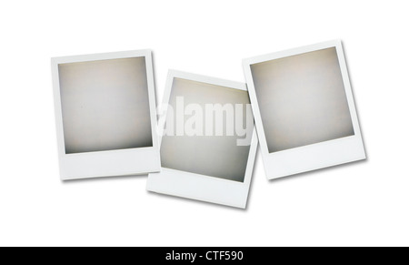 three blank polaroid pictures overhead isolated on white with clipping path - Stock Photo
