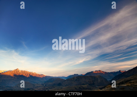 Last rays of sunset over the Remarkables, Queenstown, New Zealand - Stock Photo