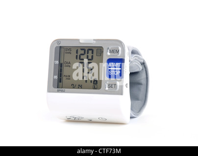Wrist blood pressure monitor on a white background - Stock Photo