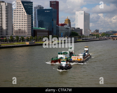 Tug boats of River Maas at Boompjes, waterfront area of central Rotterdam, Netherlands - Stock Photo