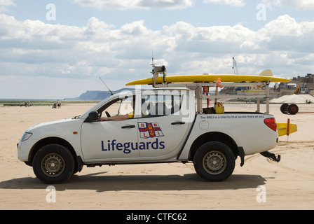 RNLI Lifeguards surveying the coast from their van - Stock Photo