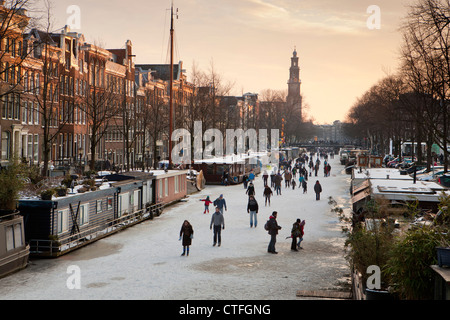The Netherlands, Amsterdam, Winter, ice skating on frozen canals. Keizersgracht. UNESCO World heritage Site. - Stock Photo