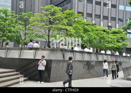 white colar in smoking space Shinjuku Tokyo Japan Asia - Stock Photo