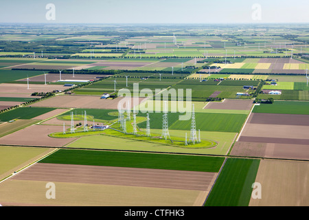The Netherlands, Zeewolde, Farms and farmland in Flevopolder. Aerial. Broadcasting TV towers. - Stock Photo