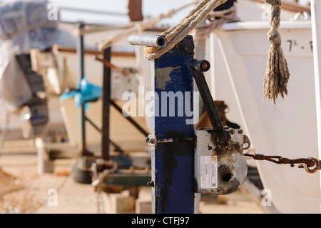 Small fishing boats tied up on land - Stock Photo
