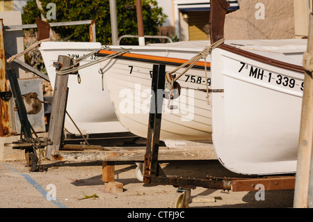 Small Spanish fishing boats tied up on land - Stock Photo