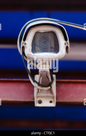 CCTV camera outside a closed down business - Stock Photo