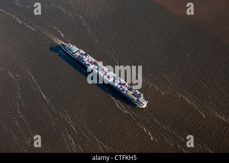 The Netherlands, Willemstad, River-vessel transporting cars. Aerial. - Stock Photo