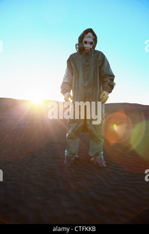 A man in protective suit and bright rays of the sun - Stock Photo