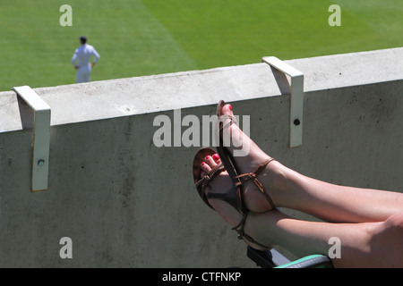 Leg of spectator of Test match cricket at the Oval, London, UK. England versus South Africa. 2nd Test. 2012 - Stock Photo