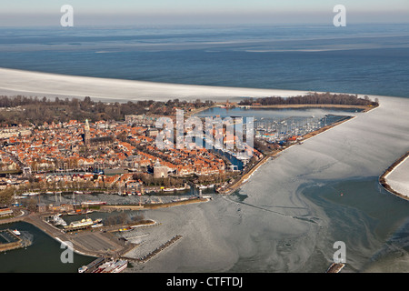 The Netherlands, Enkhuizen, Floating ice in lake called Ijsselmeer. Aerial. - Stock Photo