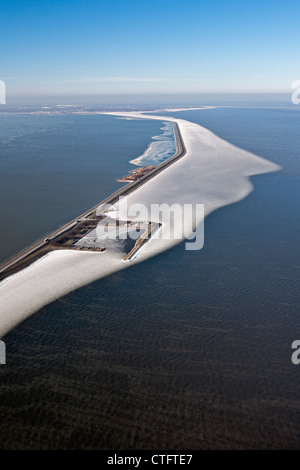 The Netherlands, Enkhuizen, dike called Houtribdijk or Markerwaarddijk. Floating ice in lake called IJsselmeer. - Stock Photo