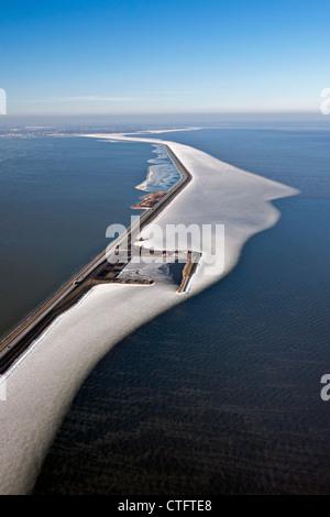 The Netherlands, Enkhuizen, dike called Houtribdijk or Markerwaarddijk. Floating ice in lake called IJsselmer Aerial. - Stock Photo