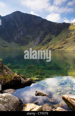 View of the pretty Cwm Cau lake nestling on Cader Idris Mountain, Snowdonia, Wales, UK - Stock Photo