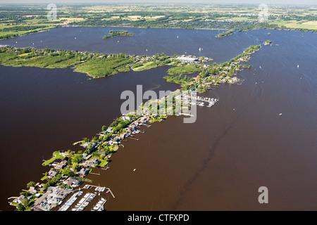 The Netherlands, Loosdrecht, Aerial. Houses near lake called Loosdrecht lakes. - Stock Photo