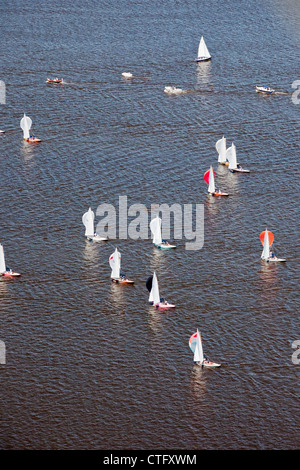 The Netherlands, Loosdrecht, Aerial. Racing of sailing boats on lake called Loosdrecht lakes. - Stock Photo