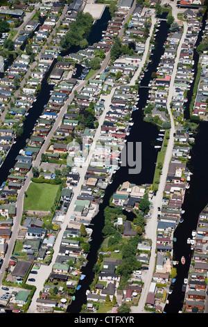 The Netherlands, Loosdrecht, Aerial. Holiday houses near lake called Loosdrecht lakes. - Stock Photo