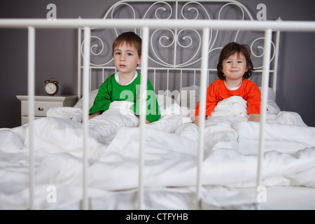 alarm,bed,bedroom,bells,boy,brother,caucasian,child,children,clock,color,decorated,duvet,expressions,faces,friends,funny,girl,good,hands,happy,head,home,making,pals,pillows,pulling,shirt,siblings,sister,smiling,white - Stock Photo