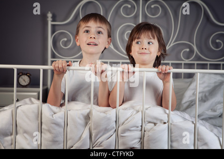 alarm,bed,bedroom,bells,boy,brother,caucasian,child,children,clock,color,decorated,duvet expressions,faces,friends,funny,girl,good,hands,happy,head,home,making,pals,pillows,pulling,shirt,siblings,sister,smiling,white - Stock Photo