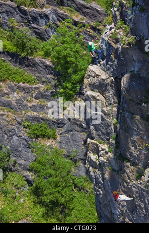 Climbers on a rock face in the Avon Gorge. The mutual reliance of the participants in this hazardous pastime is - Stock Photo