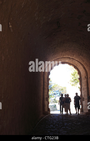 People in the entrance to Rethymnon Old Town Fortress, Crete, Greece - Stock Photo