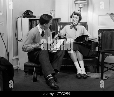 1950s Two Women Sitting Together Gossiping Under