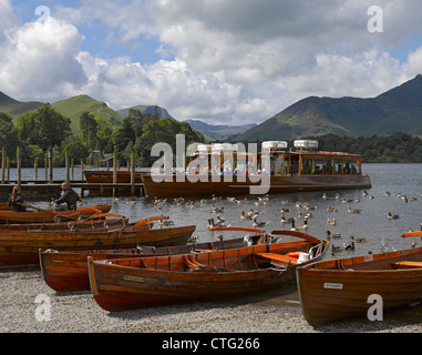 Rowing boats lined up on the shoreline of Derwentwater Keswick Cumbria England UK United Kingdom GB Great Britain - Stock Photo