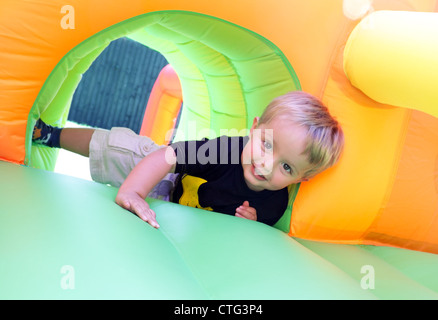 Child on bouncy castle - Stock Photo