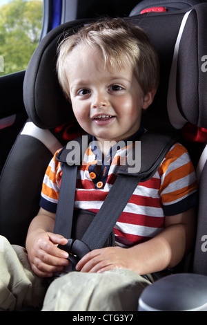 Baby boy in his child safety car seat - Stock Photo
