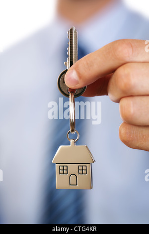 Real estate agent giving house keys - Stock Photo