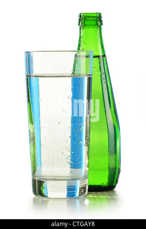 Composition with glass and bottle of mineral water isolated on white - Stock Photo
