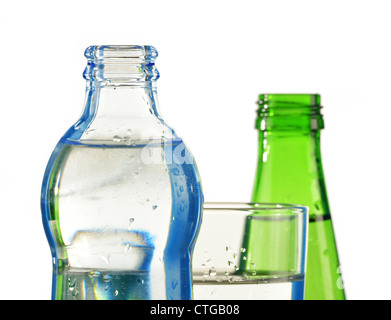 Composition with glass and bottles of mineral water isolated on white - Stock Photo