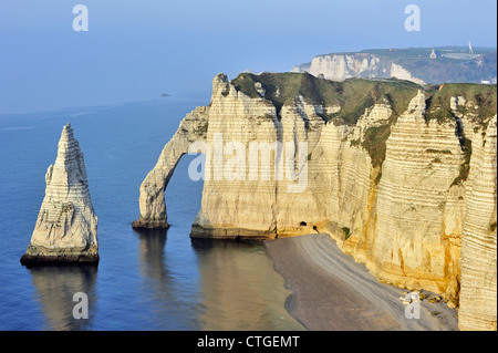L'Aiguille and the Porte D'Aval, a natural arch in the chalk cliffs at Etretat, Côte d'Albâtre, Upper Normandy, - Stock Photo