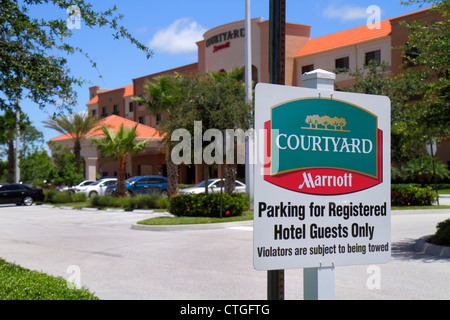 Stuart Florida Courtyard by Marriott motel hotel lodging exterior parking lot sign registered guests only warning - Stock Photo