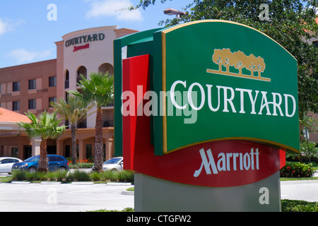 Stuart Florida Courtyard by Marriott motel hotel lodging exterior parking lot sign entrance - Stock Photo