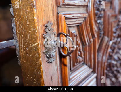 Carmona, Seville Province, Spain. Ancient door and lock in the Prioral de Santa Maria. Priory of Santa Maria. - Stock Photo