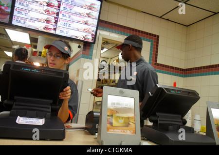 Port St. Lucie Florida Burger King fast food restaurant counter cashier woman Black man job service uniform - Stock Photo