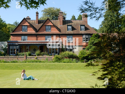 A woman relaxes in the grounds of Hergest Croft Gardens, Kington, Herefordshire - Stock Photo