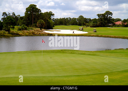 Port St. Lucie Florida Saint PGA Village Wanamaker golf course club green pond sand trap carts golfers - Stock Photo