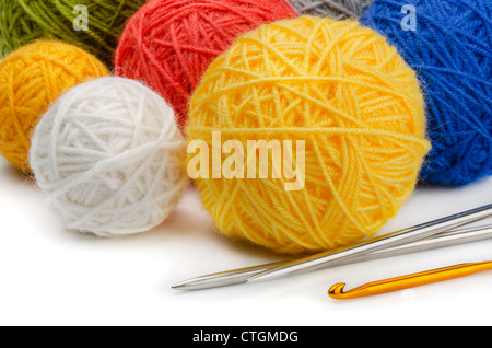 Color wool skeins, knitting needles and crochet - Stock Photo