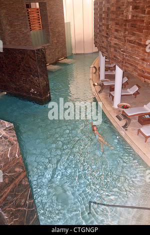 Woman swims in spa pool at Gran Velas' Riviera Maya Spa, Riviera Maya, Yucatan, Mexico. - Stock Photo